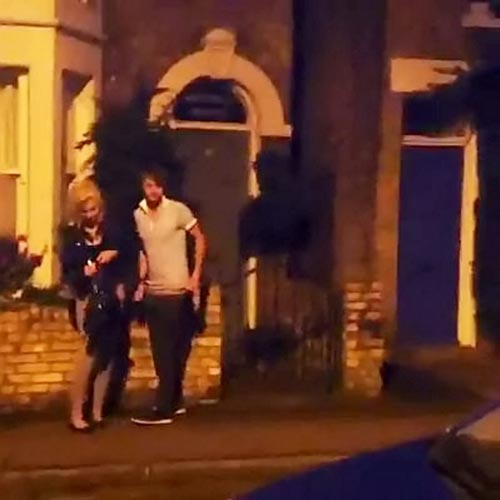 PAY-A-couple-copulating-outside-housing-on-a-well-lit-pavement-(4)