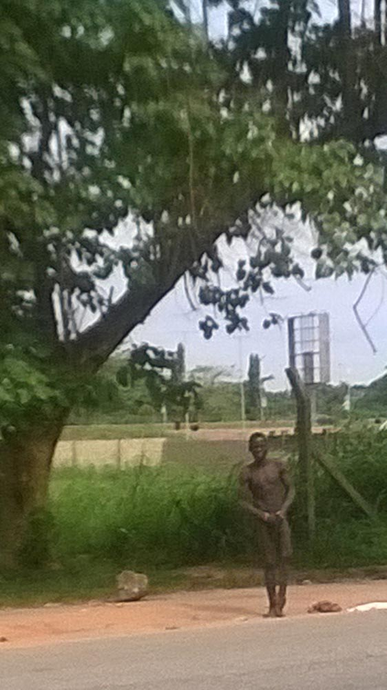The 22-year-old Boko Haram suicide bombing suspect captured on surveillance video as he undressed and attempted to wear his bomb. He was arrested at the Lagos Airport August 19, 2014 (Photo Credit: The Trent/BAB)