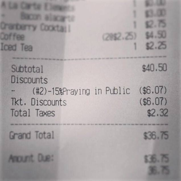 A bill indiatng discount for praying in publuc at a North Carolina restaurant. [Photo Credit: Gawker]