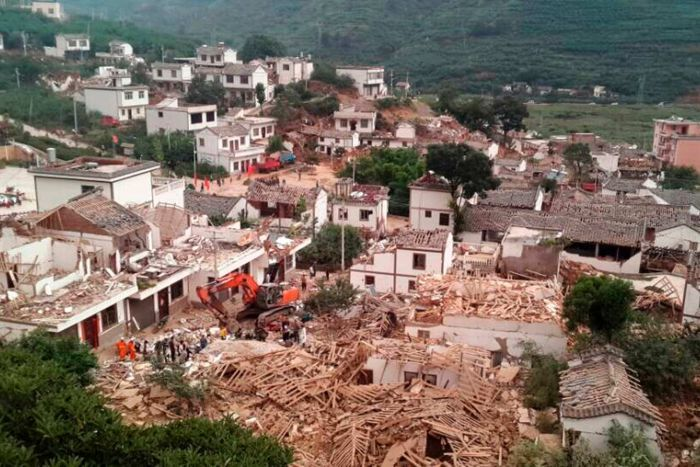 Photo Sowing collapsed buildings after the earthquake [Photo Credit: Reuters/China Daily]