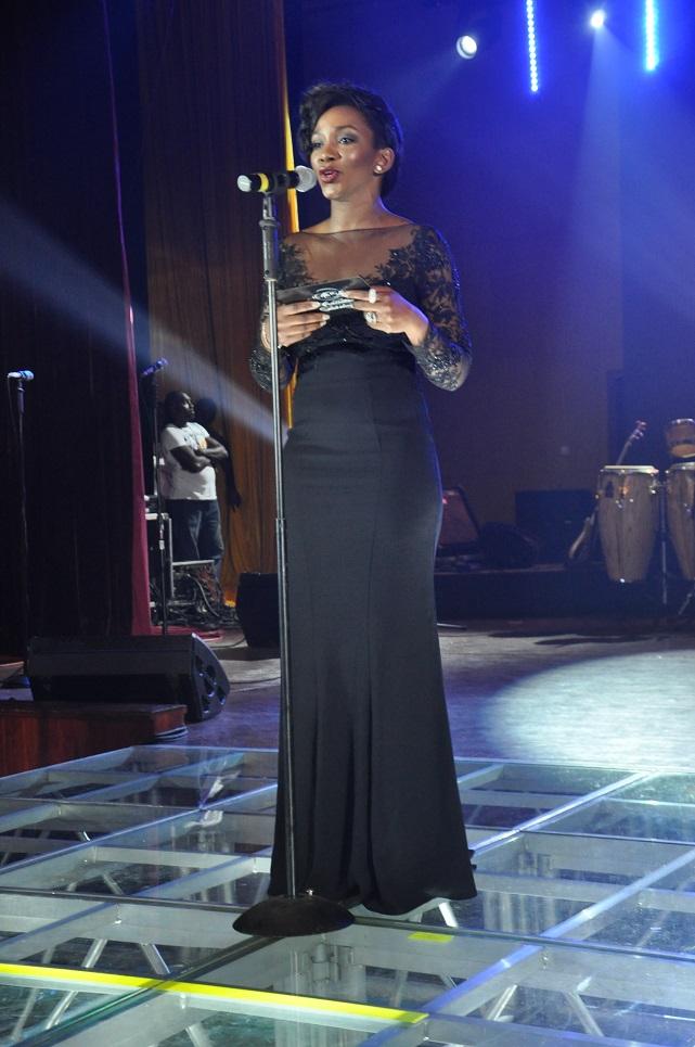 Genevive Nnaji presenting an award