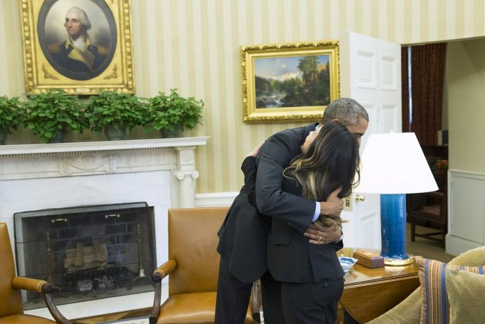 Obama hugs Nina Pham in the Oval Office of the White House in Washington on Oct. 24, 2014 (Photo Credit: Evan Vucci/Associated Press)
