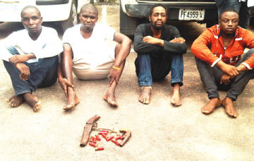 The suspects with recovered ammuntion (Photo Credit: The Punch)