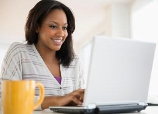 master Woman writing online laptop