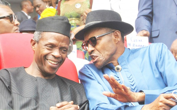 APC presidential candidate, Muhammadu Buhari (r) discussing with the running mate, Yemi Osinbajo, at APC presidential campaign rally in Port Harcourt, Rivers on Tuesday, January 6, 2014. (Photo Credit: NAN)