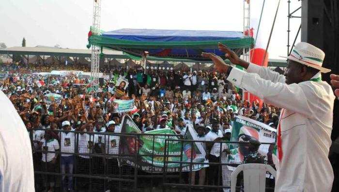 President Jonathan acknowledging cheers from the crowd at the PDP presidential campaign rally in Abia State on Friday, January 16, 2015 (Photo Credit: Reuben Abati)