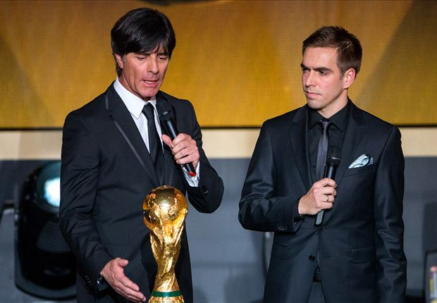 Joachim Low (Left) And Philipp Lahm (Right) At The 2014 World Cup Victory Ceremony In Berlin (Photo Credit: Goal.com)