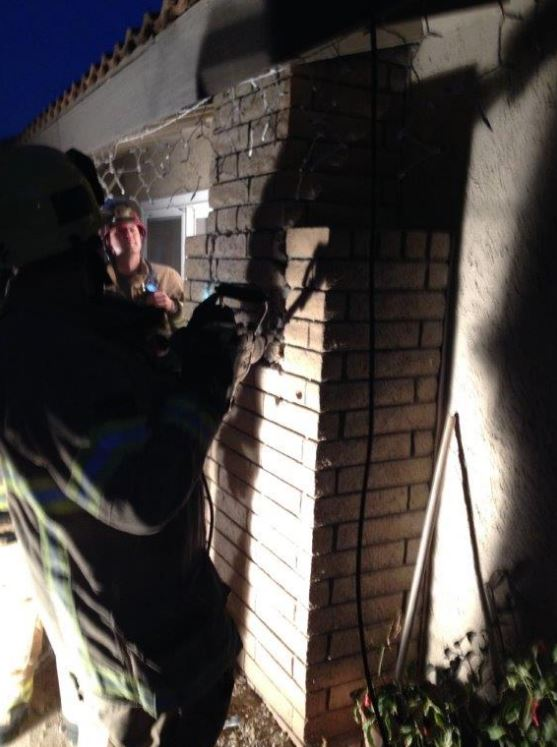 Firefighters broke into the fire place to rescue the woman (Photo Credit: Cal Fire Riverside/Twitter)