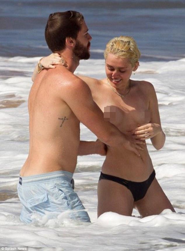 Miley Cyrus with boyfriend Patrick Schwarzenegger in Hawaii (Photo Credit: Mail Online)