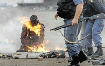 Mozambican Ernesto Nhamuave was set alight by a mob in Ramaphosa informal settlement on the East Rand in May 2008 (Photo Credit: Halden Krog)