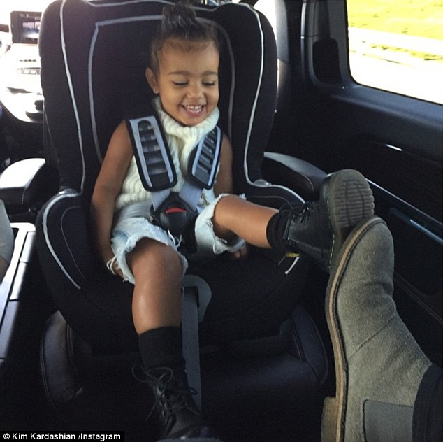 Kim Kardashian posted this Cute picture of North West Playfully touching toes with her daddy Kanye West (Photo Credit: Kim Kardashian/ Instagram)