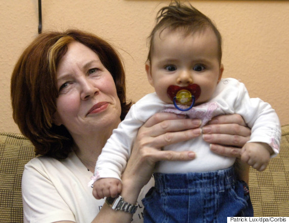 55-year-old mother Annegret Raunigk poses with her daughter Lelia on the 3rd of November in 2005. It is her 13th child and was fathered and born naturally, but unexpectedly. (Photo Credit: Patrick Lux/dpa/Corbis)