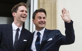 Luxembourg's Prime Minister Xavier Bettel, right, waves as he stands next to his partner Gauthier Destenay after their marriage at the town hall in Luxembourg, on Friday, May 15, 2015. The marriage comes one year after the parliament approved legislation to turn Luxembourg into an increasing number of countries allowing for same-sex marriages. Bettel and Destenay have been civil partners since 2010. (Photo Credit: AP Photo/Geert Vanden Wijngaert)