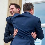 Luxembourg's Prime Minister Xavier Bettel, right, hugs his partner Gauthier Destenay as they leave the town hall after their marriage in Luxembourg, on Friday, May 15, 2015. The marriage comes one year after the parliament approved legislation to turn Luxembourg into an increasing number of countries allowing same-sex marriages. Bettel and Destenay have been civil partners since 2010. (AP Photo/Charles Caratini)