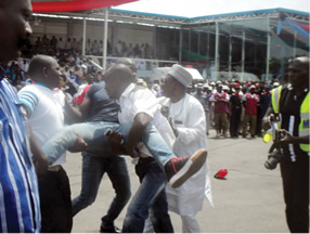 Hir Joseph being manhandled by the thugs (Photo Credit; Umar Muhhamed/Punch)