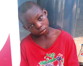 9-year-old Kingsley was on Thursday, April 30, 2015 tortured and dumped at a fuel station in Lagos State by his mum, Blessing Goodluck because he greeted herneighbour who she was not in good terms with. (Photo Credit: Punch)