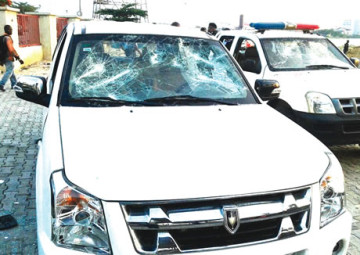 Some vehicles vandalised by some matchete wielding Okada riders protesting the arrest of some of their members in Lekki Phase 1 area of Lagos State on Wednesday, May 7, 2015. (Photo Credit: Punch)