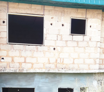 The uncompleted building on Sefu Elelede Street in the Ibafo area of Ogun State where an unidentified man hanged himself on Wednesday, April 29, 2015. (Photo Credit: Punch)