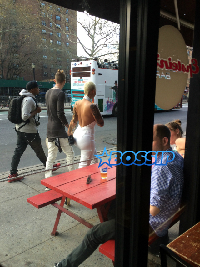 Amber Rose was spotted on Thursday, April 28, 2015 holding hands with her new rapper boyfriend, Machine Gun Kelly, as they strolled in Manhattan, New York. (Photo Credit: Bossip)
