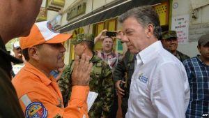 Colombian President, Juan Manuel Santos, at the scene. (Credit: AFP)