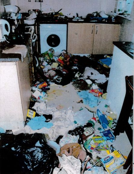 Some environmental health workers were shocked to discover a disgusting home with a rotting corpse after they joked earlier on whether there was a dead body inside the squalid home in Knowsley, Merseyside. (Photo Credit: Liverpool Echo)