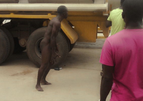 Unidentified man removed his clothes in protest after he was unable to buy fuel at Petrocam petrol station in Igando, a suburb in Lagos state.