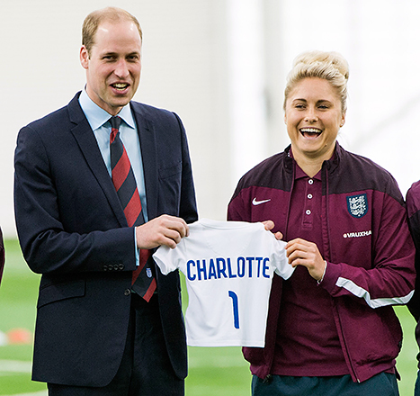 Prince William receiving a jersey for Princess Charlotte (Credit: USweekly)