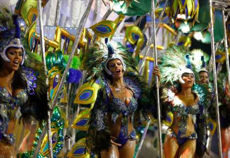Revelers from the Unidos da Tijuca samba school participate in the annual carnival parade in Rio de Janeiro's Sambadrome February 17, 2015. (Photo REUTERS/Pilar Olivares