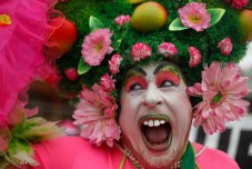 "A reveler performs during the Banda de Ipanema carnival parade in Rio de Janeiro, Brazil, Saturday, Jan. 31, 2015. Rio's over-the-top Carnival is the highlight of the year for many local residents. Hundreds of thousands of merrymakers are beginning to take to the streets in open-air ""blocos"" parties. (AP Photo/Silvia Izquierdo)"
