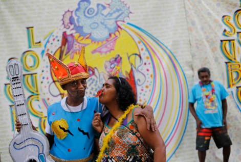 "Patients from the Nise de Silveira mental health institute stand in costume before the institute's carnival parade, coined in Portuguese: ""Loucura Suburbana,"" or Suburban Madness, in Rio de Janeiro, Brazil, Thursday, Feb. 12, 2015. Patients, relatives and workers of the institute held their parade one day before the official start of Carnival. (AP Photo/Silvia Izquierdo)"