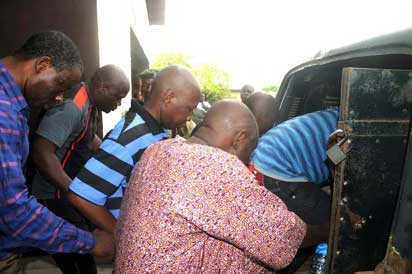 The suspects boarding a bus back to prison in Ibadan, yesterday. (Photo Credit: Dare Fasube)
