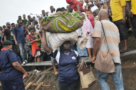 One of The Traders Affected By The Fire At Iyana-Ipaja (Photo Credit: Vanguard)