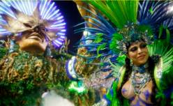 Revellers from the Vila Isabel samba school participate in the annual carnival parade in Rio de Janeiro's Sambadrome, February 16, 2015. REUTERS/Sergio Moraes (BRAZIL - Tags: ENTERTAINMENT SOCIETY) TEMPLATE OUT