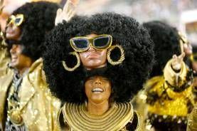 A reveler from the Uniao da Ilha samba school participates in the annual carnival parade in Rio de Janeiro's Sambadrome, February 17, 2015. REUTERS/Sergio Moraes (BRAZIL - Tags: SOCIETY)