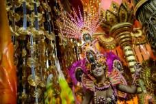 A Beija Flor samba school performer parades on a float during Carnival celebrations at the Sambadrome in Rio de Janeiro, Brazil, Tuesday, Feb. 17, 2015. (AP Photo/Felipe Dana)