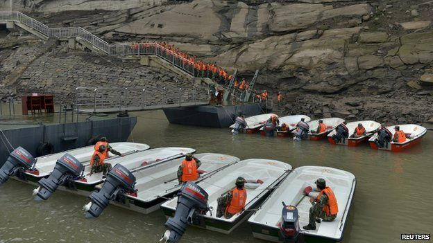 Emergency personnel and rescue teams  on of the rescued 15 survivors being pulled out by rescuers (Credit: BBC/AFP)