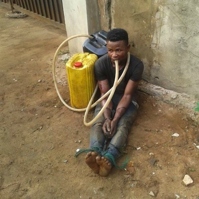 The man whose identity was not disclosed was caught by a vigilante guard in the area at about 4am on Wednesday, May 27, 2015 who noticed some diesel on the ground around the parked truck. (Photo Credit: Daily Post)