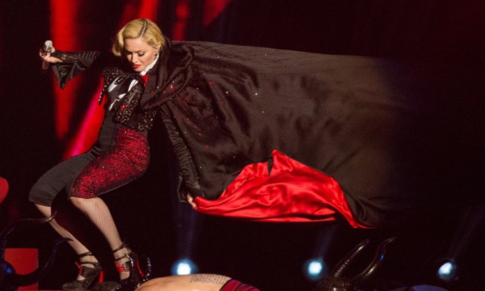 Madonna in a black red cape