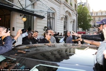 Her body guards helping her get into the car (Credit: GC Images)