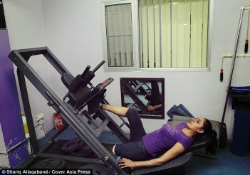 Subhreet, here working out in a gym in Chandigarh, had to learn how to walk on one leg and was turned down from numerous dance schools because of her disability (Credit: Cover Asia Press)