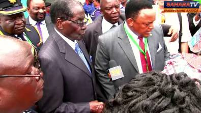 VIDEO: Nigerian Journalists Ambush Robert Mugabe At Inauguration