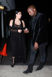 Pregnant Kim Kardashian stepped out for a dinner at a restaurant in Santa Monica, California, with her nipples and boobs on display. (Photo Credit: AKM.com)