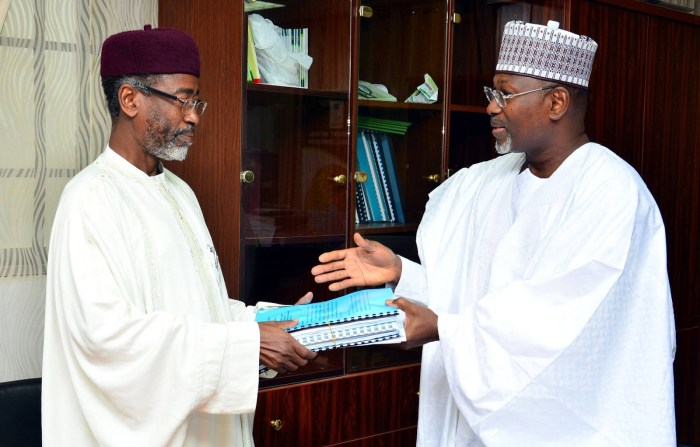Chairman Independent National Electoral Commission (INEC) ,Attahiru Jega (right) handing over to the former Acting Chairman, Ahmed Wali during the handover ceremony on Tuesday, June 30, 2015 at the commission's Headquarters in Abuja . (Photo Credit: Gbemiga Olamikan)