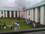 Fire guts the newly built PG hostel at the Michael Okpara University Umudike, Abia State in the early hours of Tuesday, July 7, 2015. (Photo Credit: Witness)