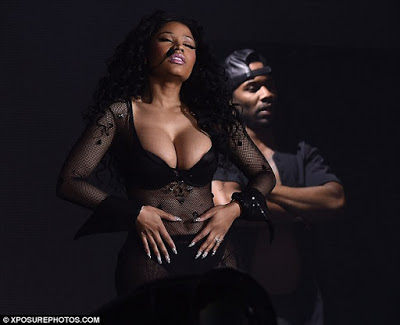 American rapper, Nicki Minaj has suffered a major wardrobe malfunction as her nipple slipped out of her bra on stage while she performed at London's Wireless Festival in the evening of Sunday, July 5, 2015. (Photo Credit: Eroteme.co.uk)