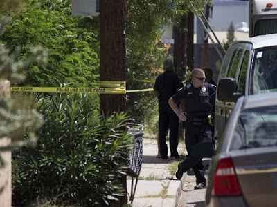 Phoenix police officere were called to the scene at 13th Place and Colter Street, where a naked man decapitated woman, two dogs and then cut his own arm and plucked his eye. (Photo Credit: Phoenix Police)