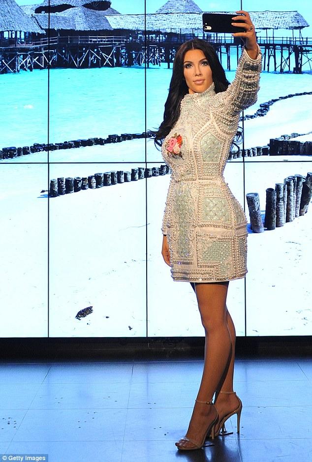 Kim Kardashian Selfie taking wax figure (Credit: Getty Images)