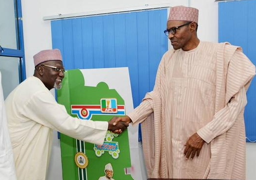 DG of the DSS, Lawal Musa Daura, pictured in a handshake with General Muhammadu Buhari