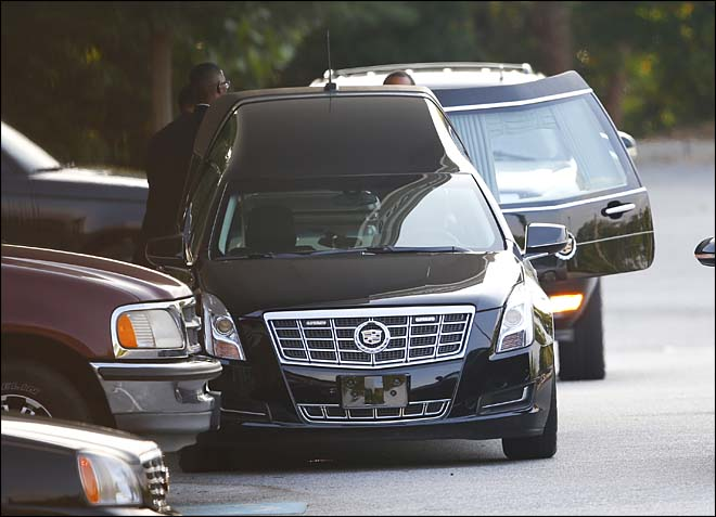 A hearse is unloaded before a funeral service for Bobbi Kristina Brown Saturday, Aug. 1, 2015, in Alpharetta, Ga.  Brown, the only child of Whitney Houston and R&B singer Bobby Brown, died in hospice care July 26, about six months after she was found face-down and unresponsive in a bathtub in her suburban Atlanta townhome. (Photo Credit: AP/John Bazemore)