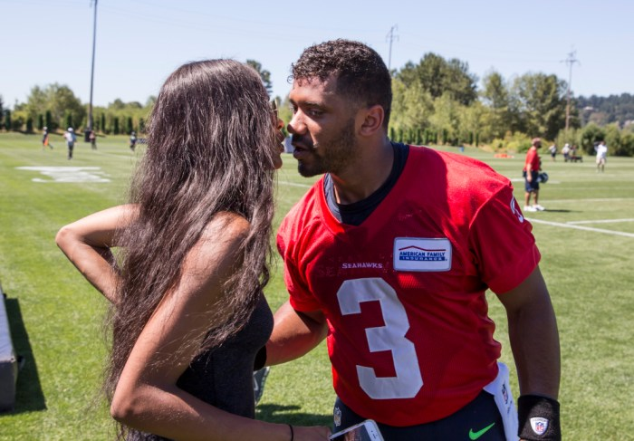 Seattle Seahawks quarterback Russell Wilson, right, kisses Ciara after an NFL football training camp on Friday, July 31, 2015, in Renton, Wash. (AP Photo/Stephen Brashear) ORG XMIT: WASB104
